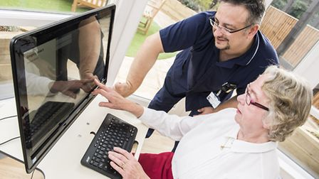 An elderly patient uses the dementia software at Queen Elizabeth Hospital in King's Lynn. The softwa