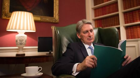 Chancellor of the Exchequer Philip Hammond reads through his Autumn Statement. Picture: Stefan Rouss
