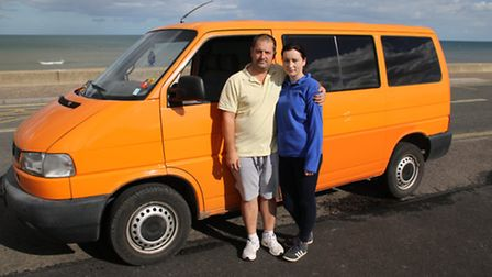 George and Ina Reddell, from Walcott, with the minibus they bought to travel home. Picture: ALLY McG
