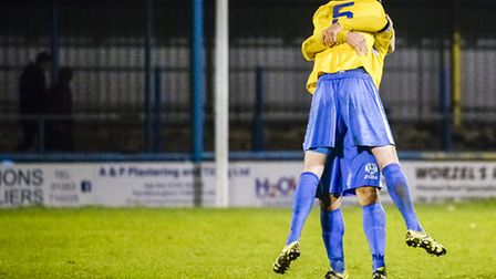 Action from King's Lynn Town v St Ives at The Walks in the FA Trophy - The Lynn Players celebrate th