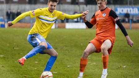 Action from King's Lynn Town v St Ives at The Walks in the FA Trophy - Lynn's Ryan Hawkins on the ba