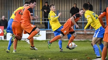 Action from King's Lynn Town v St Ives at The Walks in the FA Trophy - Lynn's Toby Hilliard heads th