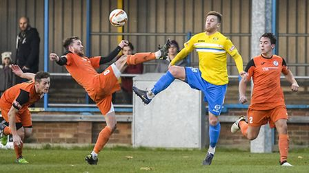 Action from King's Lynn Town v St Ives at The Walks in the FA Trophy - Lynn's Lee Stevenson challeng