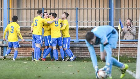 Action from King's Lynn Town v St Ives at The Walks in the FA Trophy - Lynn's Michael Clunan celebra
