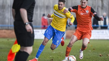 Action from King's Lynn Town v St Ives at The Walks in the FA Trophy - Lynn Ryan Hawkins on the ball