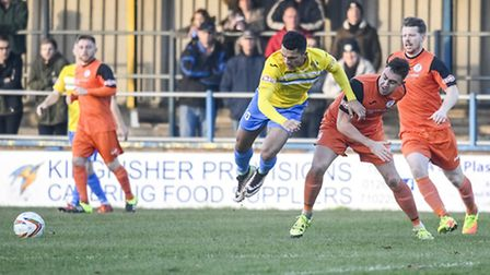 Action from King's Lynn Town v St Ives at The Walks in the FA Trophy - Lynn's Kurtis Revan is challe