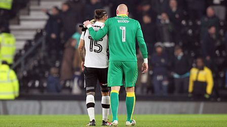 Former Norwich City team-mates Bradley Johnson and John Ruddy share a moment at the final whistle. P