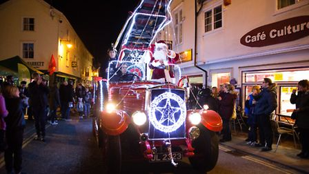 Just in time for the lights to be switched on, Santa rides in style on this old school fire engine a