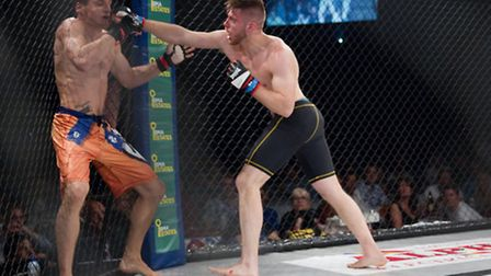 Andre Goncalves, right, lands a big right hand against Aaron Khalid in their classic fight at Conten