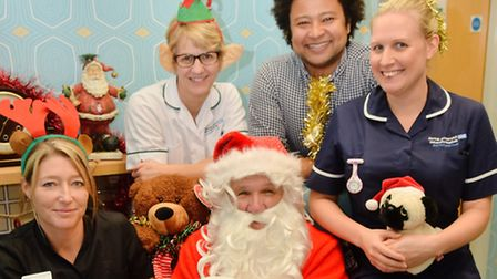Father Christmas helps staff at the Norfolk and Norwich hospital launch the Christmas present appeal