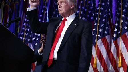 President-elect Donald Trump pumps his fist during an election night rally, Wednesday, Nov. 9, 2016,