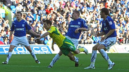 Wes Hoolahan scores a rare goal with his head at Cardiff in October 2010 - his 20th goal for the Can