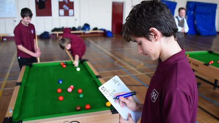 Pupils at Sheringham High School play snooker to aid with their maths skills. Alex Kol, 13, adds up
