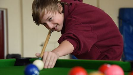 Pupils at Sheringham High School play snooker to aid with their maths skills. Martin Glover, 13, tak