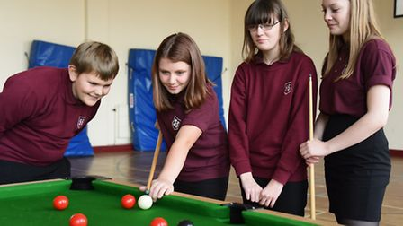 Pupils at Sheringham High School play snooker to aid with their maths skills. Olivia Evans, 13, plan