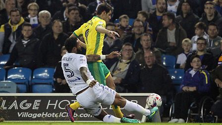 Nelson Oliveira of Norwich and Kyle Bartley of Leeds United in action during the EFL Cup match at El