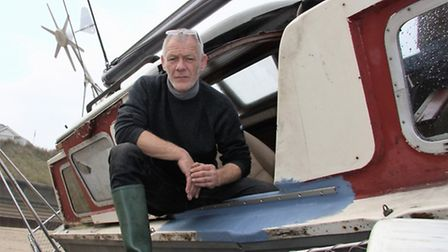 Sailor John Favell on his stricken yacht Mithril. Picture: MAURICE GRAY