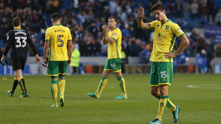 Timm Klose of Norwich apologises to the traveling Norwich fans at Brighton. Picture: Paul Chesterton