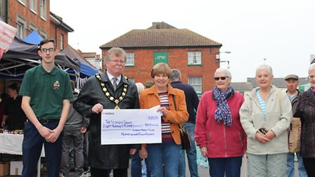 North Walsham Mayor Barry Hester and town councillor Robert Murphy (left) present a cheque to member