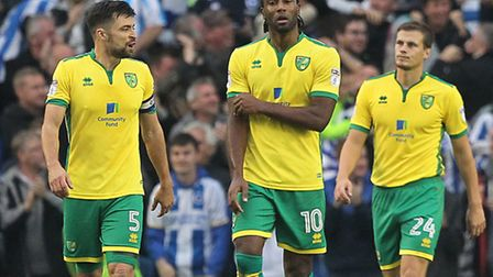 Norwich players, from left, Russell Martin, Cameron Jerome and Ryan Bennett, look dejected after con