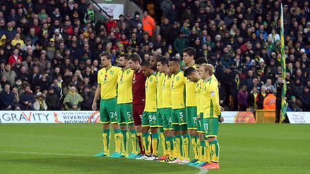 The Norwich City players paused prior to the take game to mark Remembrance Day later this week. Pic