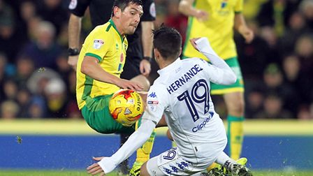 Graham Dorrans tackles Pablo Hernandez as Leeds United come out on top at Carrow Road. Picture by Pa