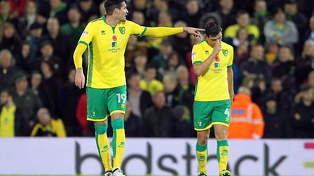 Graham Dorrans cuts a dejected figure as Norwich City concede a third and fatal goal to Leeds United
