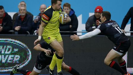Leicester Tigers' George Catchpole and Saracens' Alex Goode during the Aviva Premiership match at Al