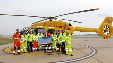 The first £500 being handed over at the EAAA's base at Norwich Airport.