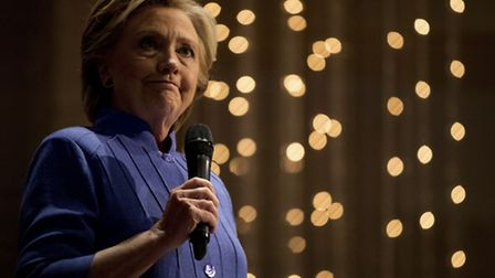 Democratic presidential candidate Hillary Clinton pauses while speaking at New Mount Olive Baptist C