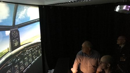 Neil Bignell mans the controls of a Lancaster bomber, with John Hoyte and Eric Quinney, at Sim-Fly a