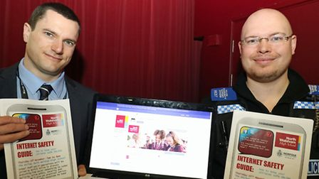 NWHS network manager Gary O'Connor and PCSO James Harding with the Internet Safety Guide. Picture: A