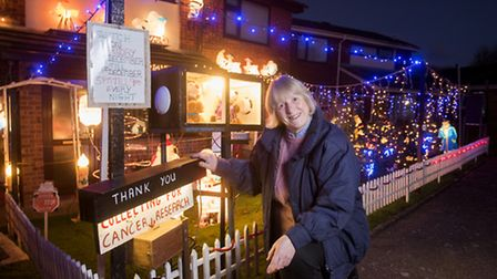 Sue Sanford outside her home in Harleston. She has decorated her home for Christmas to raise funds f