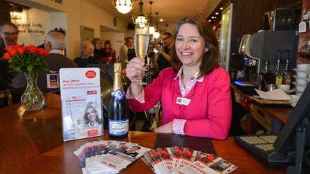 Victoria MacDonald opening the new Post Office at the bar in the Cellar House pub in Eaton, Norwich