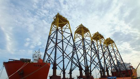 Wind turbine jackets loaded on a boat, waiting to be installed at Wikinger offshore wind farm in Ger