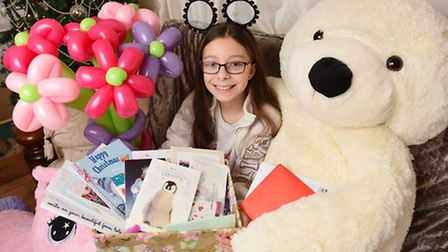 Faith Constance surrounded by gifts donated by well-wishers as Tokens for Faith to keep her smiling