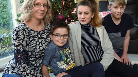 Blake Barley, eight, second left, with his family, mum Debbie, sister Beth, 14, and brother Bryce, 1