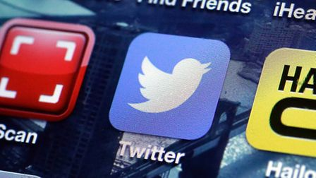A Twitter app on an iPhone screen is shown. Photo: AP Photo/Richard Drew, File.