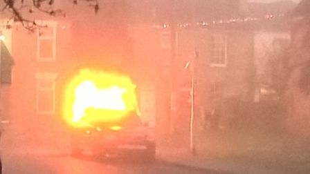 A car on fire in Priory Road, Downham Market. Pic: Geoffrey Hunter.