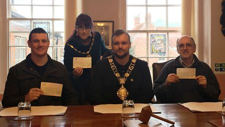 Eight charities have received donations from the Thetford mayor's charity fund. (L-R) Phil Williams