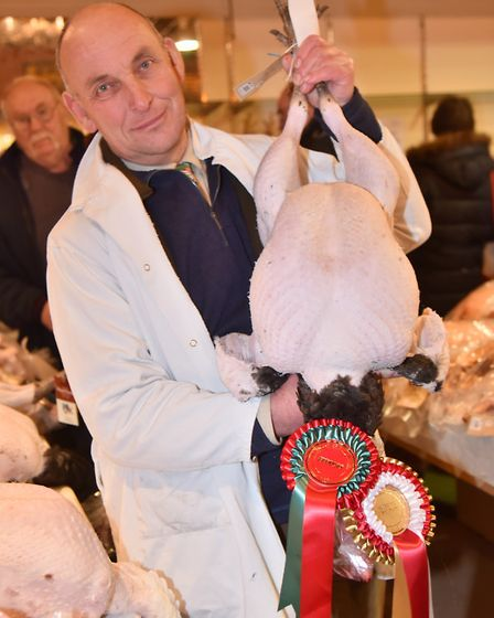 The annual TW Gaze turkey and poultry auction 2016 in Diss.Judge Chris Mobbs with the best in show t