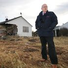 EDP editor Nigel Pickover surveys the damage at Walcott in the wake of the 2013 storm surge. Picture