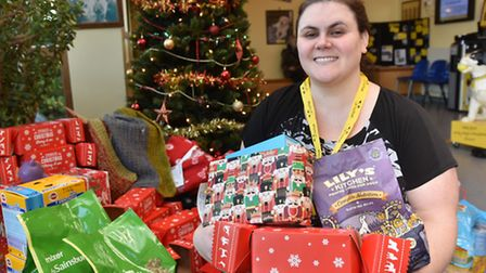 Dog treats at Christmas, at the NCDL in Snetterton.Ava Winter with some of the donations under the t
