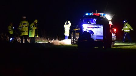 Emergency services attend the scene of a car that has fallen off the cliff at Corton, Suffolk.