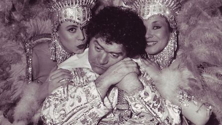 The Welsh wizard of the wisecracks gets some comfort from panto showgirls Kay Michelle (left) and Vi