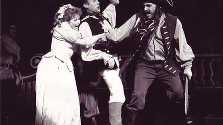 Robinsoe Crusoe is captured by Blackbeard in Theatre Royal panto. Photo: Archant Library