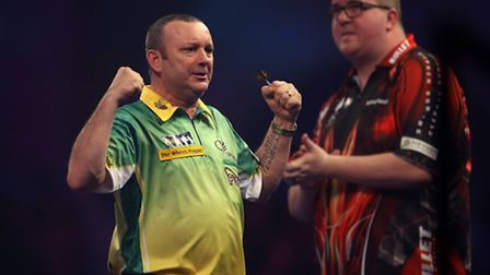 Darren Webster celebrates beating Stephen Bunting during day three of the William Hill World Darts C