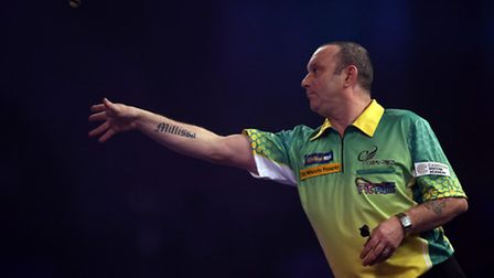 Darren Webster in action during the walk on during day three of the William Hill World Darts Champio