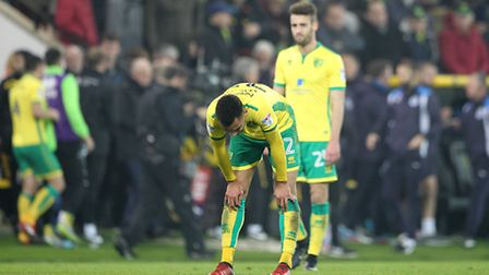 Ivo Pinto of Norwich and Jacob Murphy cut dejected figures at the end of Norwich City's latest Champ