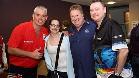 Dart players Steve Beaton (left), Colin Lloyd and Kevin Painter with darts fan Zoe Moore. They will